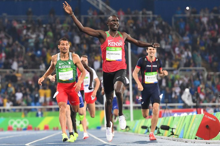 Kenya's David Lekuta Rudisha (C) celebrates as he crosses the finish line to win the Men's 800m Final during the athletics event at the Rio 2016 Olympic Games at the Olympic Stadium in Rio de Janeiro on August 15, 2016.   / AFP / OLIVIER MORIN