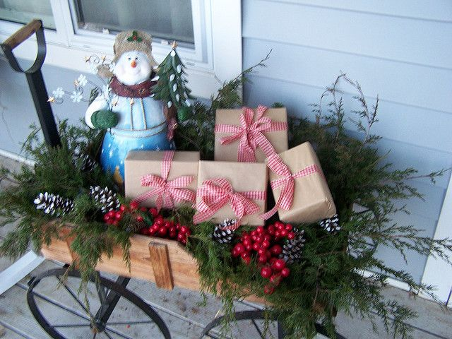 Wagon full of greenery and Christmas packages.