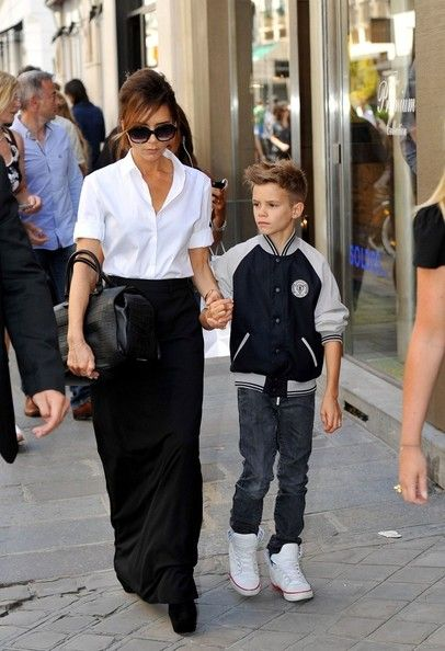 Victoria Beckham Button Down Shirt  Victoria's tucked-in button-down is a prime example of minimalism at its chicest.  Victoria Beckham Long Skirt  Victoria looks like she's ready to stroll the streets of France in this structured black maxi.