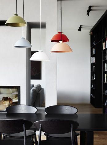 coloured pendant lights at varying heights in black & white dining room, by Templeton