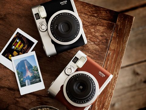 Black polaroid Fujifilm  Designed with a classic look, the instax mini 90 offers advanced features, such as bulb and double exposures, that are attractions of traditional analog cameras and offer an enhanced capability to capture light creatively.