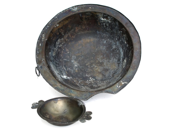 Mary Rose. bowl with the indentation is for shaving and is designed to fit around the neck and under the chin of a man being shaved. It would hold soap and warm water. This bowl has a 5 litre capacity and is made of brass.