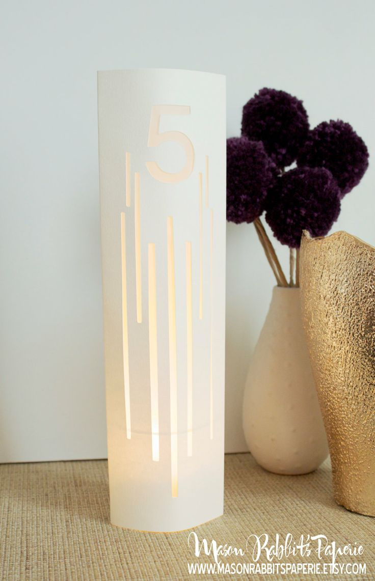 Lines Wedding Table Number Luminaries / Table Markers / Modern Table Numbers / Art Deco Table Numbers. $2.50, via Etsy.