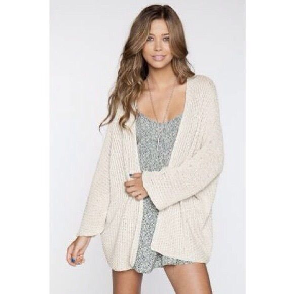 Brandy Melville cardigan Brandy Melville cream cardigan. Tag is cut off because it would hang outside of sweater. Like new, worn maybe twice Brandy Melville Sweaters Cardigans