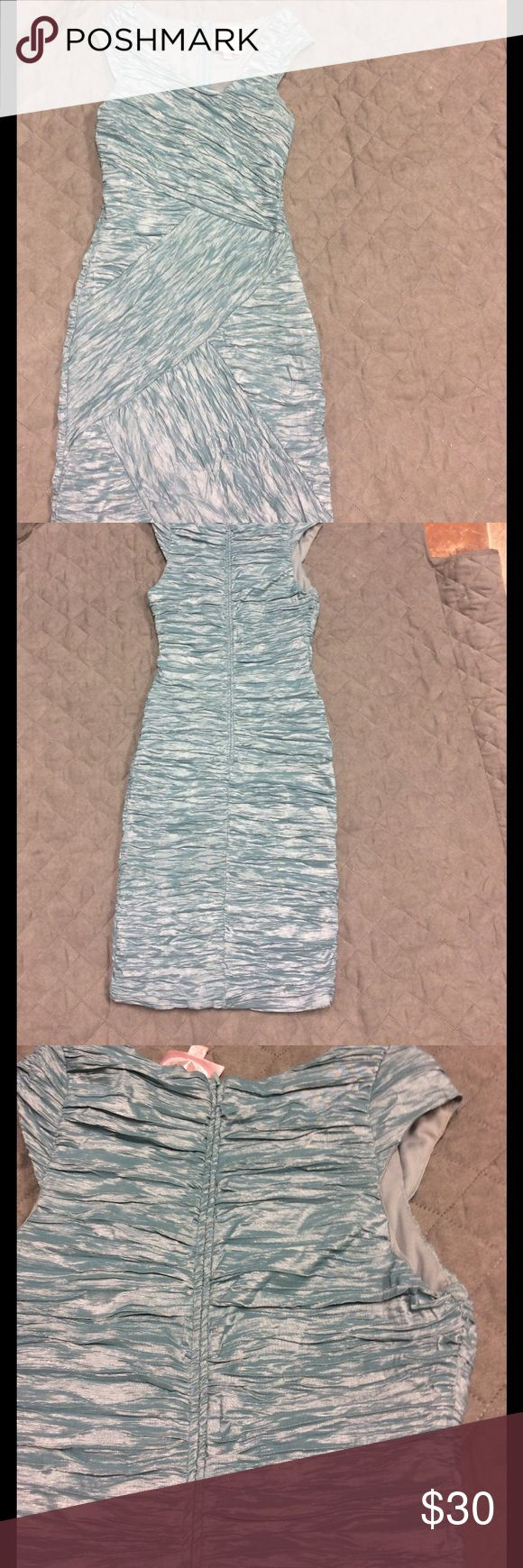 Light teal 👗 Dress Lovely form flattering light teal with asymmetrical neckline. Fabric shimmery silver/scrunchy layered. Soft lining. Zipper down back Size Small EUC. Hits bottom of knee. Romeo & Juliet Couture Dresses Asymmetrical