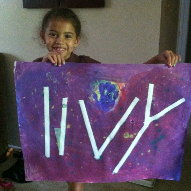 """We used masking tape to spell """"livy"""" and then fingerpainted our hearts out!  Removed tape after the paint dried and voila!   A masterpiece!!!!"""
