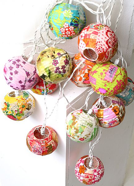 Paper-covered string lights.  Can you imagine these draped over a funky velvet headboard?  Oh yeah.
