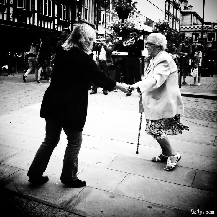 iPhoneography { dancing on lincoln high street } - By my standards it is quite journalistic with very little post processing. This image demonstrates to me the importance of my iPhone because it was taken when my new iPhone5 was being repaired. Instead of leaving the house empty handed, I took my old iPhone4 purely in case an iPhoneography opportunity presented itself. The iPhone truly is an iCamera to me.