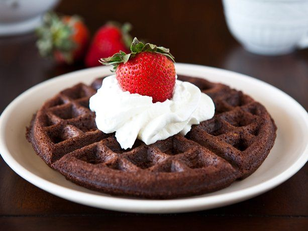 1 box (1 lb 3.8 oz) Betty Crocker® Supreme walnut brownie mix   3 eggs   1/4 cup vegetable oil   Whipped cream topping (from aerosol can) or frozen (thawed) whipped topping   Fresh strawberries