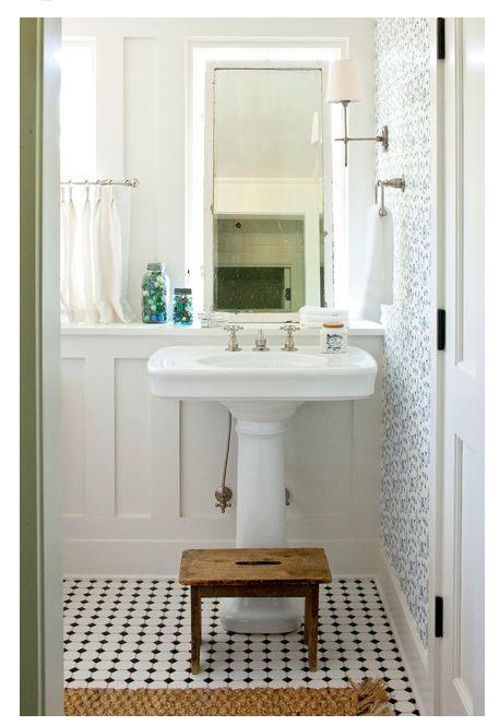 pattern wallpaper / pedistal sink / mirror leaning up against low set wall shelf / builtin wall shelf detail / pattern tile