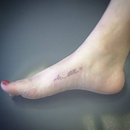 Be still together with a heart on the foot. Tattoo...