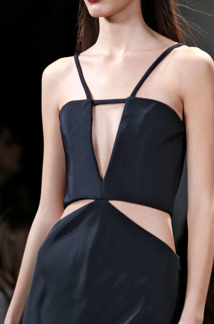 Chic black dress with graphic cut outs; geometric fashion details