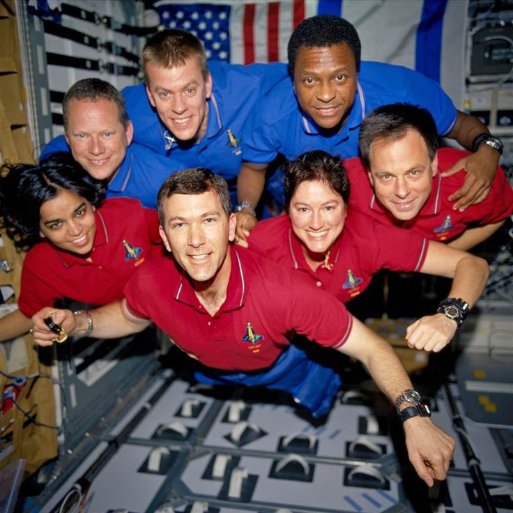 "Recovered from the debris... This picture of Columbia's crew members was on a roll of unprocessed film recovered from the debris after the shuttle's disintegration. The crew members strike a ""flying"" pose for their traditional in-flight crew portrait in the Spacehab research module. From left (bottom row), wearing red shirts to signify their shift's color, are Kalpana Chawla, commander Rick Husband, Laurel Clark and Ilan Ramon. From left (top row), wearing blue shirts, are David Bro"