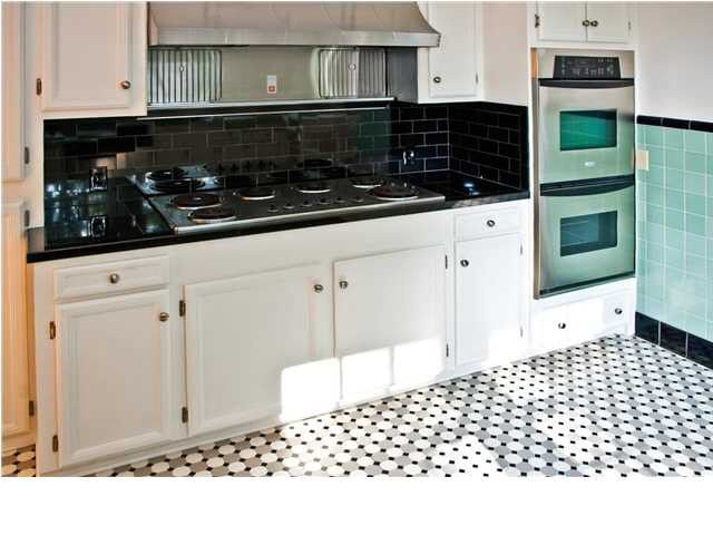 kitchen with black floor tiles 1949 traditional house flora ms kitchen with teal and 8738