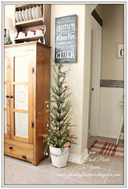 small decorated Holiday / Christmas tree in a bucket.  perfect for a country kitchen: