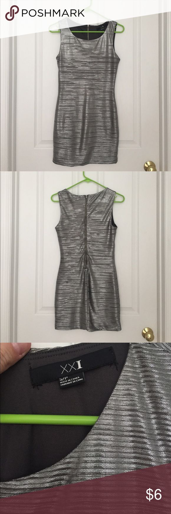 Forever 21 Silver Small Party Dress Super cute good used condition Silver party dress from Forever 22, size small. This dress was only worn once! Fun shiny silver material makes it a great party/going out dress. Tank style with somewhat of a rouching style and a zipper back. Forever 21 Dresses Mini
