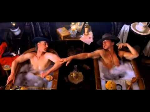 Shanghai Noon -  Starring Jackie Chan, Owen Wilson, Lucy Liu, Roger Yuan, Xander Berkeley, and Walton Goggins -    It involves two men of different personalities and ethnicities (a Chinese imperial guard and a Western outlaw) who team up to stop a crime.