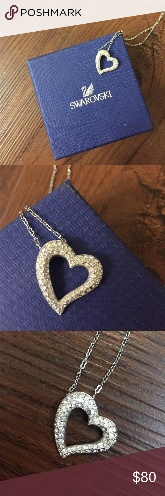 Swarovski Heart Necklce Like new! Only worn a couple times. Beautiful Swarovski heart pendant with silver chain. Authentic box included. Swarovski Jewelry Necklaces