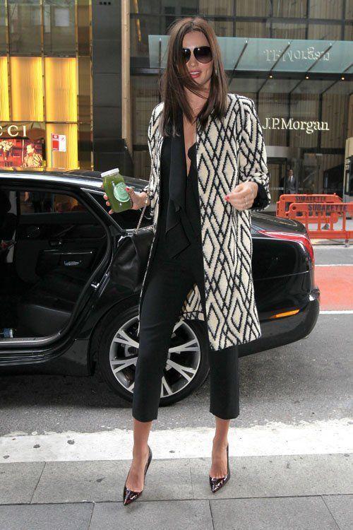 Miranda Kerr wearing a black Givenchy ruffle-front blouse under a geometric pattern Tucker coat, Manolo Blahnik patent tortoise pumps, Dita aviator sunglasses and sporting a Valentino Grande Lock Bag #StreetStyle