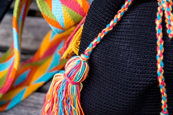 This beautiful handmade bag has a colorful strap to make itfun. Take it to a festival, for a walk in the park or a visit to the farmers market. This bold bag w