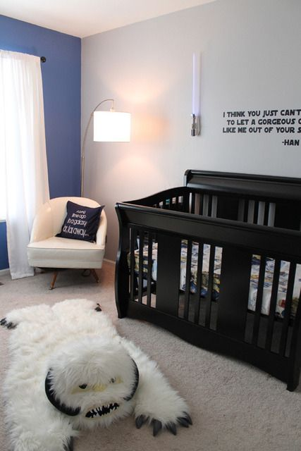 Star Wars nursery: Han Solo quote on the wall, wampa rug on the floor.  WIN!