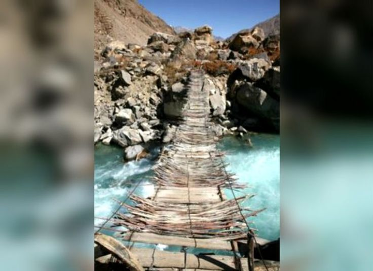 Old Hanging Bridge, Afghanistan This bridge is known for being one of the scariest bridges in the world. The rickety bridge hangs low to the river underneath. The bridge may be scary, but the views are spectacular.