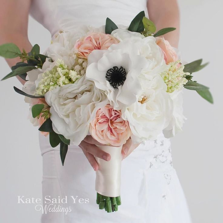 Anemones give this silk bridal bouquet a fun pop!  Silk wedding bouquet by Kate Said Yes Weddings.