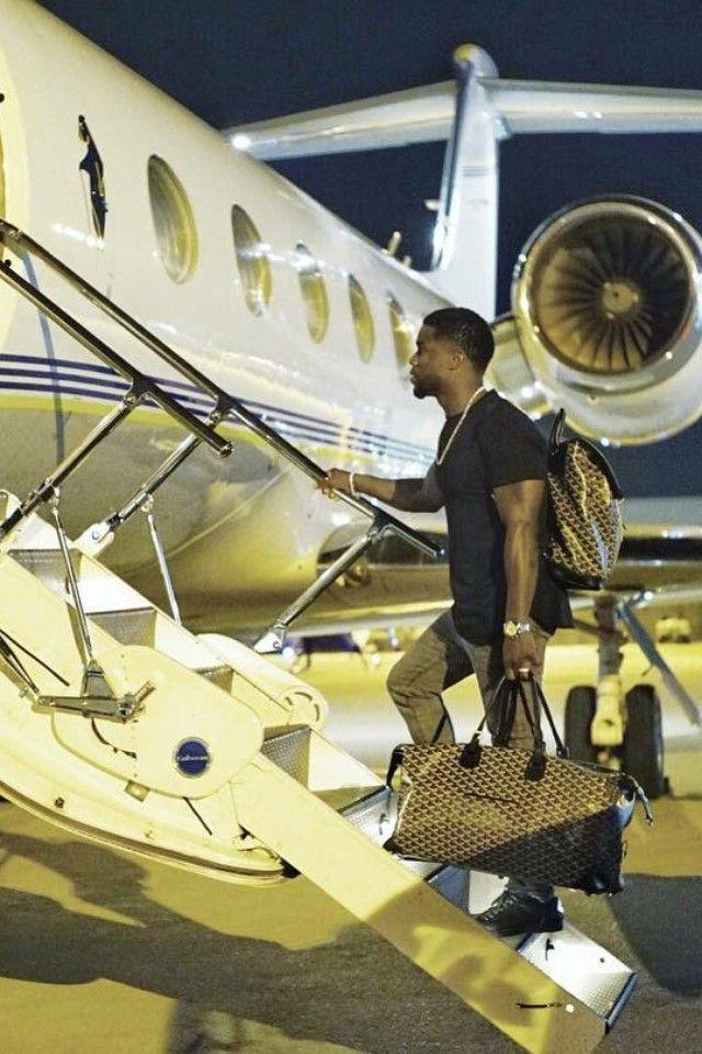 Kevin Hart wearing  Goyard Backpack, Goyard Duffle