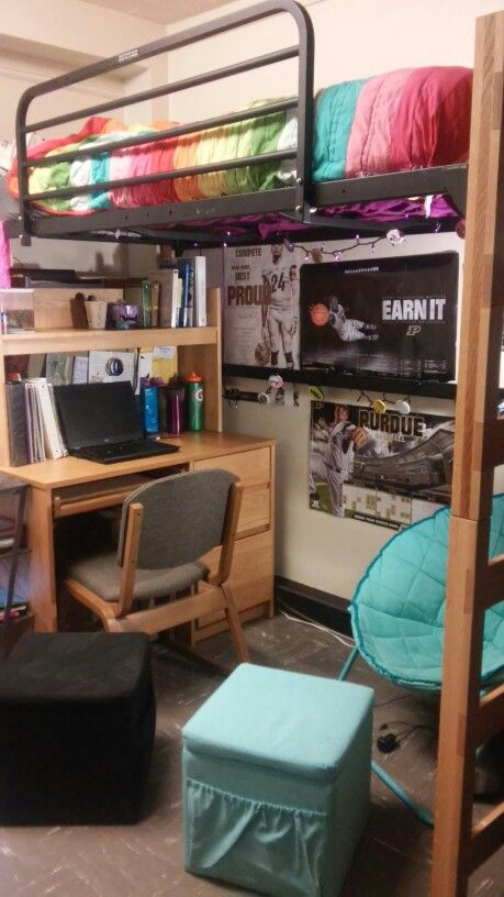 Purdue University dorm room. The square ottomans from target double as seating and storage.