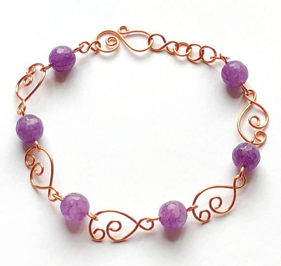 Beautiful wire bracelet with faceted amethyst beads, made with copper wire. Bracelet is handmade with copper designer links and spiral wire clasp. Beads are glass, semi precious beads, faceted beads, round, and very lovely. Wire jewelry, jewelry, copper wire, wire, bracelet, wire