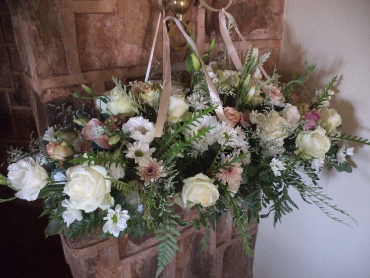 Mariana Visagie's lovely arrangements designed to flank the altar space