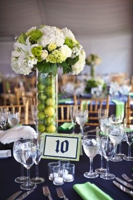 Like the limes or could put green apples in vase and then peacock feathers and flowers in the top for centerpieces...