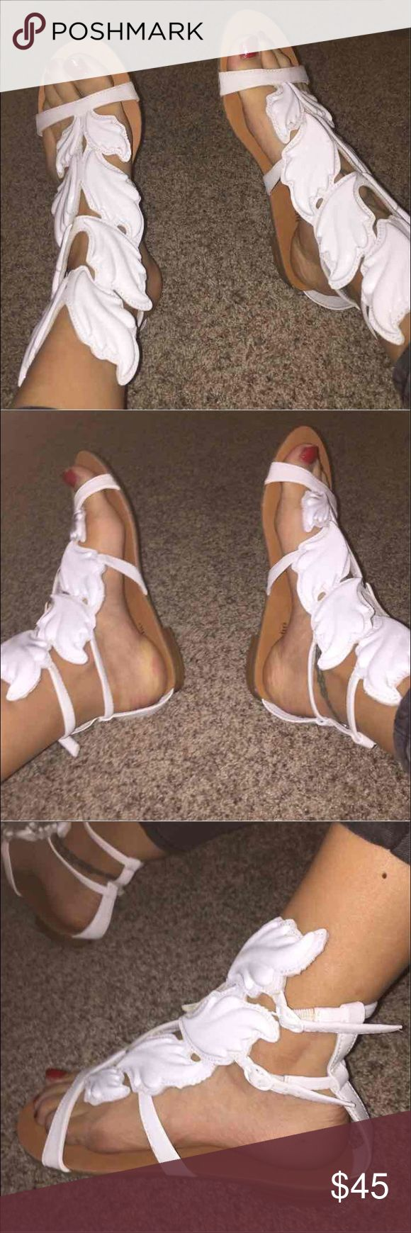 Cute white wing sandals look like guiseppe zanotti These are super cute and go with literally anything!! They are size 8.5 . The bottoms look brand new.  The shoes have no major signs or wear either . They look like the shoes Giuseppe zanotti and Kanye west released a few years ago. You will love them !! They do go up your ankle just a tad bit.  Brand is zigi soho Shoes Sandals