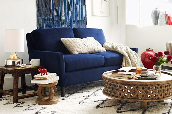"""Just because you have to choose small-scale furniture doesn't mean you're limited to pieces that are basic — or worse, safe. Instead, make a splash with a dramatic hue, a really luxe fabric, or both. This West Elm loveseat has minimalist lines and a scaled-down size that will work beautifully in a studio, but it's also a statement piece you'll want to keep when you upgrade to a bigger pad. "" http://www.refinery29.com/60678#slide1"