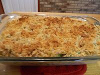 A Retro Throwback of Tuna Noodle Casserole with Ritz crackers, cream of mushroom soup, egg noodles, peas, milk, tuna