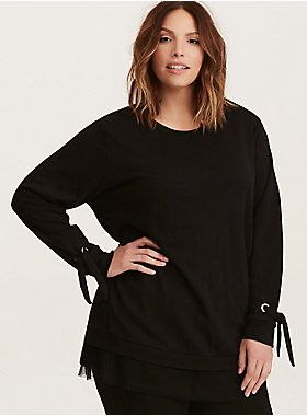 """Streetwear goes chic on this sweatshirt. The laidback classic hasn't shed its comfort - with a black French Terry knit - or its chill silhouette - with a pullover crew neck and ribbed trim. But details, details, elevate it to """"could be worn to dinner"""" status - check out the cool tie grommet sleeves and frilly mesh-trimmed bottom.     Model is 5'9.5"""", size 1     Size 1 measures 34"""" from shoulder  Cotton/polyester  Wash cold, dry low  Imported plus size sweatshirt"""