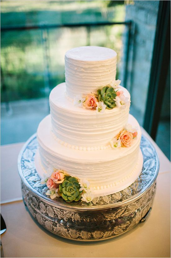 This is from weddingchicks.com…a wedding blog. Three tier white wedding cake by blue note bakery