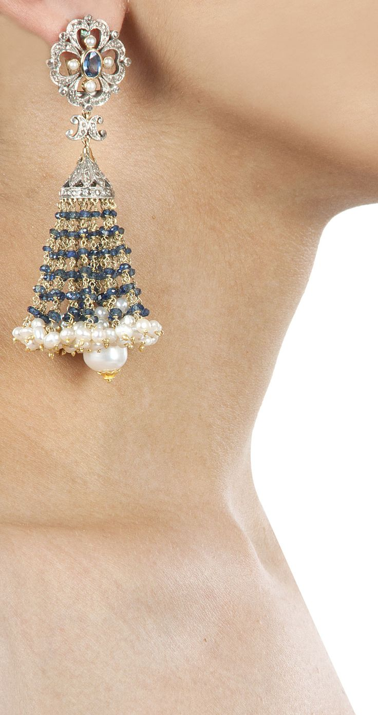 Floral head earrings with sapphire by Amrapali. http://www.perniaspopupshop.com/designers-1/amrapali
