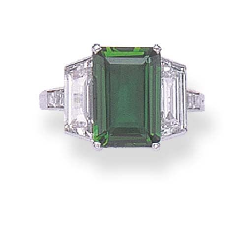 AN EXQUISITE ART DECO EMERALD AND DIAMOND RING, BY TIFFANY & CO.   Set with a rectangular-cut emerald, weighing approximately 2.77 carats, flanked on either side by trapeze-cut diamonds, to the square-cut diamond shoulders, mounted in platinum, circa 1930  Signed Tiffany & Co.