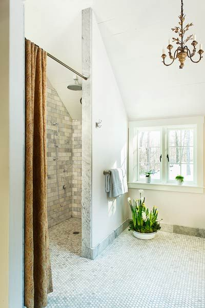 The centerpiece of the Essex House master bath is a curbless shower. Measuring 4 by 8 feet, it has room for both a person in a wheelchair and an attendant, and the fixtures are placed so that you can fine-tune the water temperature before stepping into the spray. | Photo: Anthony Tieuli | thisoldhouse.com