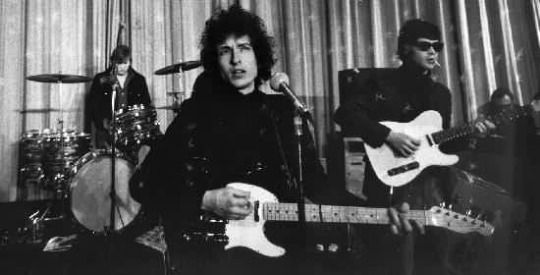 Bob Dylan in 1966 with The Hawks aka The Band and also Al Kooper. Some people thought Dylan was trying to replicate the Byrds' folk rock sound with the Band.