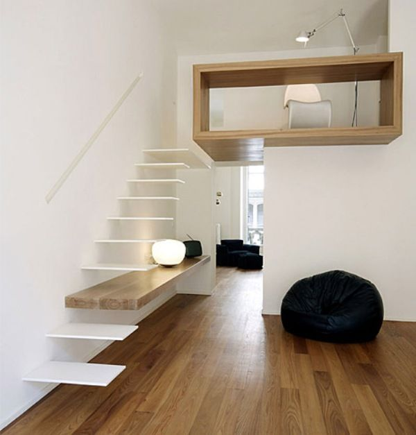 italian firm studioata designed this small space with an loft above that is connected by simple floating white stairs