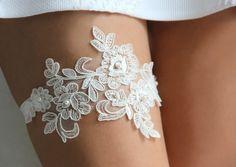 "Wedding garter, ivory wedding garter, Lace wedding garter, Pearl garter, flower garter, ivory lace garter ""Lace and pearls garter"" style 111 by HoneyPieBridal on Etsy https://www.etsy.com/listing/211398112/wedding-garter-ivory-wedding-garter-lace"