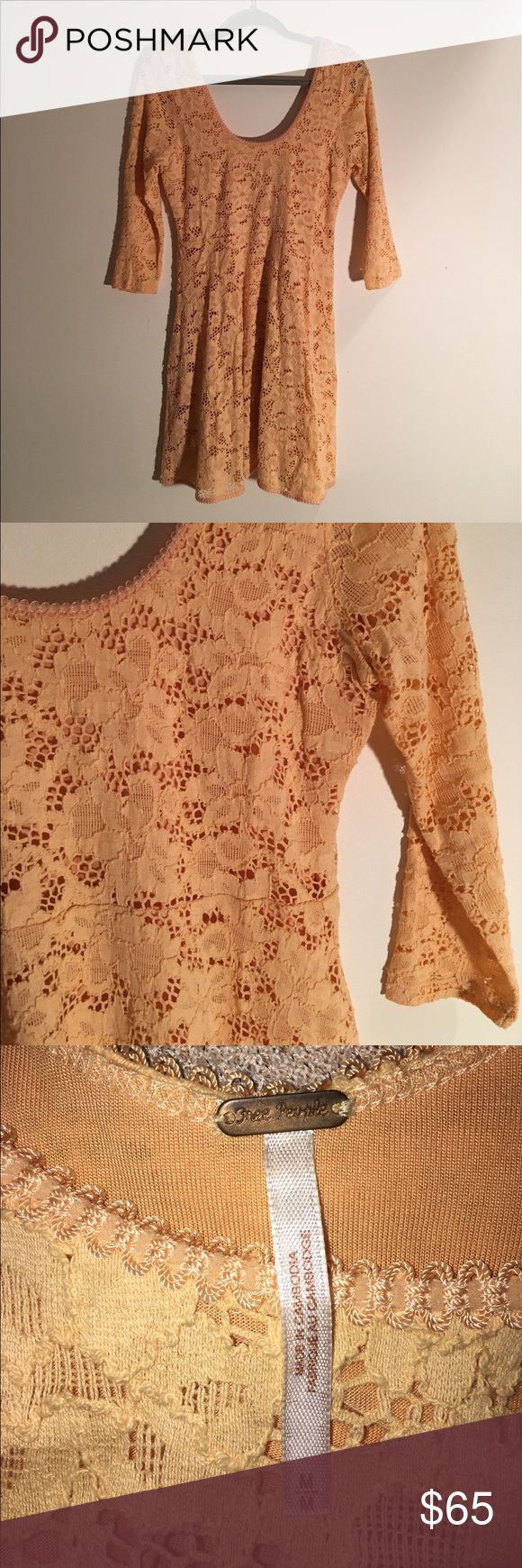 Free People Lace Dress Worn once! Floral lace dress in a beautiful peachy orange color, perfect for summer!  Scoop neck and back. 3/4 length sleeve. Great condition, worn once with no stains or rips! Free People Dresses Mini
