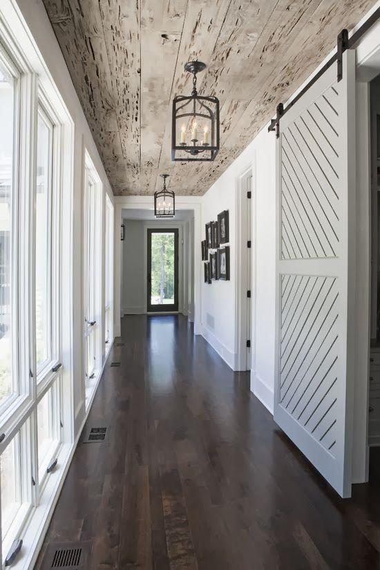 Love the long windows, ceiling, dark wood floors, sliding barn door…