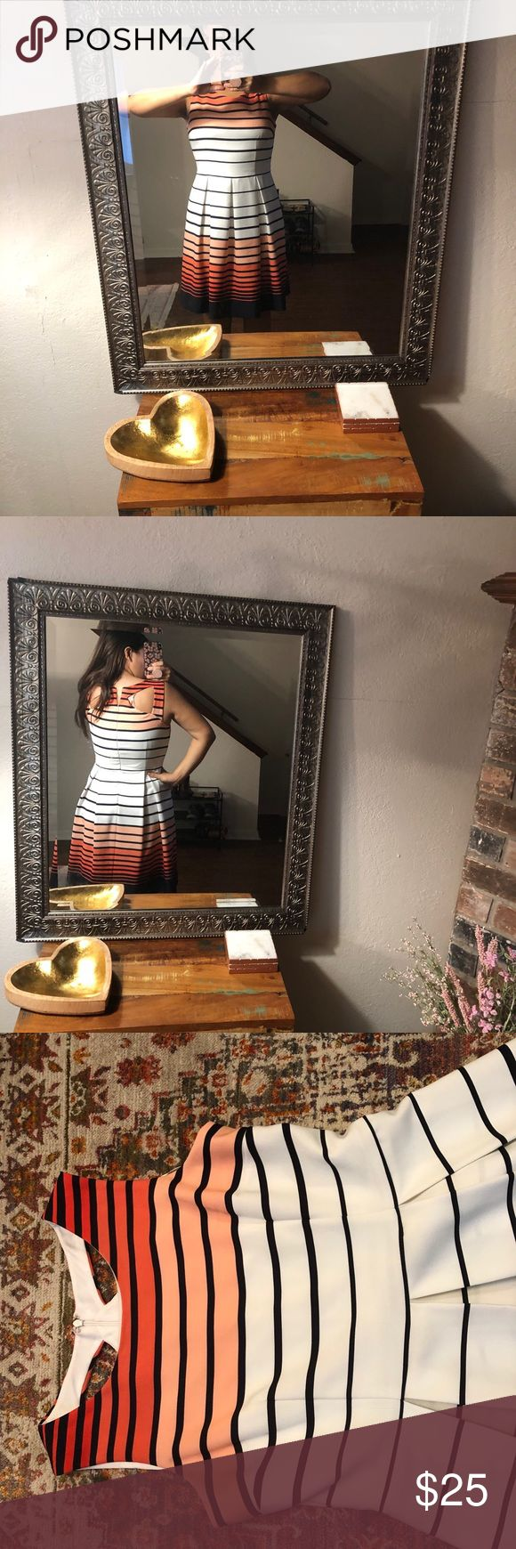 Studio one New York This is a white dress with navy blue stripes and peach and o…