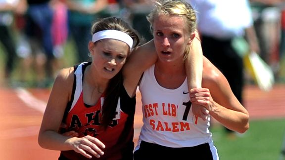 Meghan Vogel, 17, helps collapsed rival Arden McMath, 16, over the finish line in the 3,200 meter race at their high school track meet. This is a beautiful story.