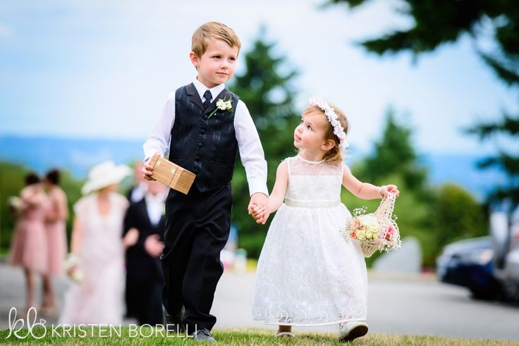 Flower girl and ring bearer walking down the aisle at a British Columbia wedding. Wedding in Burnaby.