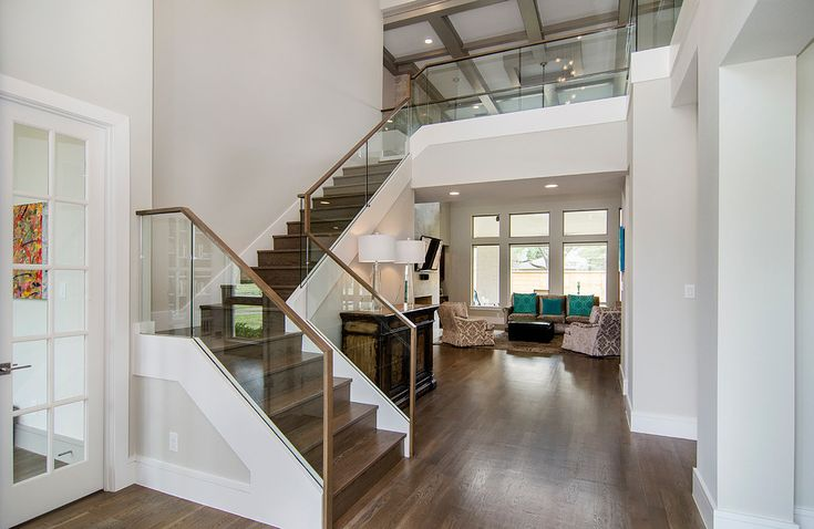 glass stair railing in Staircase Contemporary with coffered ceiling catwalk