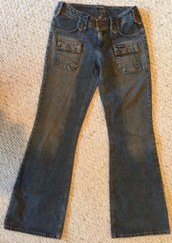 Women's Silver Jeans, Medium Wash Denim with handsome fading details, flare, Low Rise. Handsome belt loops and pocket work. GUC